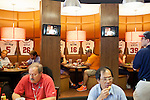 Customers eat lunch at the Atlanta Braves All Star Bar and Grill in Concourse D at Hartsfield–Jackson Atlanta International Airport in Atlanta, Georgia on August 28, 2013.
