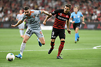 1st January 2020; Bankwest Stadium, Parramatta, New South Wales, Australia; Australian A League football, Western Sydney Wanderers versus Brisbane Roar; Nicolai Muller of Western Sydney Wanderers held off the ball by Jay O'Shea of Brisbane Roar - Editorial Use