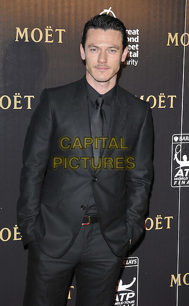 Luke Evans.attended the Barclays ATP World Tour Finals official launch party, Battersea Power Station, Cringle St., London, England, UK, 17th November 2011..half length black suit tie shirt  hands in pockets .CAP/CAN.©Can Nguyen/Capital Pictures.
