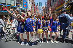 June 15, 2014, Tokyo, Japan - Japanese football fans pose for photographers after watching the FIFA World Cup Brazil 2014 Group C match between Japan and Cote d'Ivoire in the Shibuya district in Tokyo on Sunday, June 15, 2014. Cote d'Ivoire beat Japan in a 2-1 victory in the preliminary round match during the 2014 FIFA World Cup in Recife, Brazil. (Photo by AFLO)