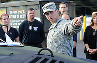 SFC David Melendez points out some of the armored vehicles on base during an Honorary Commander boot camp for 40 local officials Thursday October 29, 2015 at Joint Base McGuire-Dix-Lakehurst  in Fort Dix, New Jersey. Participants experienced combined arms training, simulated combat environments and enjoyed a military cuisine. (Photo by William Thomas Cain)