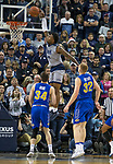 Nevada forward Jordan Caroline (24) dunks the ball against South Dakota State in the second half of an NCAA college basketball game in Reno, Nev., Saturday, Dec. 15, 2018. (AP Photo/Tom R. Smedes)