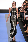 Hanna R walks runway in a Hanna R carbon black crepe racer column gown with liquid silver paneled embroidery, by Monique Lhuillier, from the Monique Lhuillier Spring 2012 collection fashion show, during Mercedes-Benz Fashion Week Spring 2012.