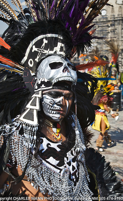 A menacing dancer with a black feathered headress, skull and face paint dances in celebration at the Virgin of Guadalupe Feast Day in Mexico city, December 12.