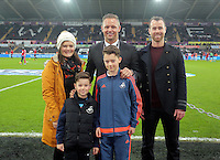 Academy player with Lee Trundle during the Barclays Premier League match between Swansea City and West Bromwich Albion played at the Liberty Stadium, Swansea on December 26 2015
