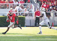 ATHENS, GA - SEPTEMBER 7: James Cook #4 tries to elude Kendrick Catis #6 during a game between Murray State Racers and University of Georgia Bulldogs at Sanford Stadium on September 7, 2019 in Athens, Georgia.