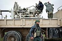 SYRIA: members of the brigade thuwwar ar-Raqqa (FSA) are preparing the big artillery on the front about ten kilometers from the town of Tal Abyad.<br /> <br /> SYRIA: des membres de la brigade Thuwwar ar-Raqqa (FSA) déploient la grosse artillerie sur le front à une dizaine de km de la ville de Tal Abyad.