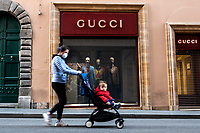 A woman with her child walks past Gucci shop in Rome during Italy's lockdown due to Covid-19 pandemic. <br /> On May 4th will start the phase 2 of the measures against pandemic, adopted by Italian government, that will allow some construction and factory workers to go back to work . <br /> Rome 30/04/2020 <br /> Photo Andrea Staccioli Insidefoto