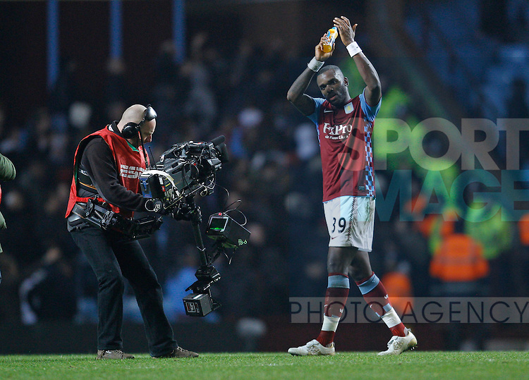 Darren Bent of Aston Villa takes the applause at the end of the game