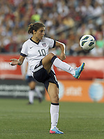 USWNT midfielder Carli Lloyd (10) volley pass. In an international friendly, the U.S. Women's National Team (USWNT) (white/blue) defeated Korea Republic (South Korea) (red/blue), 4-1, at Gillette Stadium on June 15, 2013.