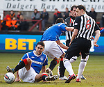 Lee McCulloch and David Healy both swing at the same ball and get in each other's way