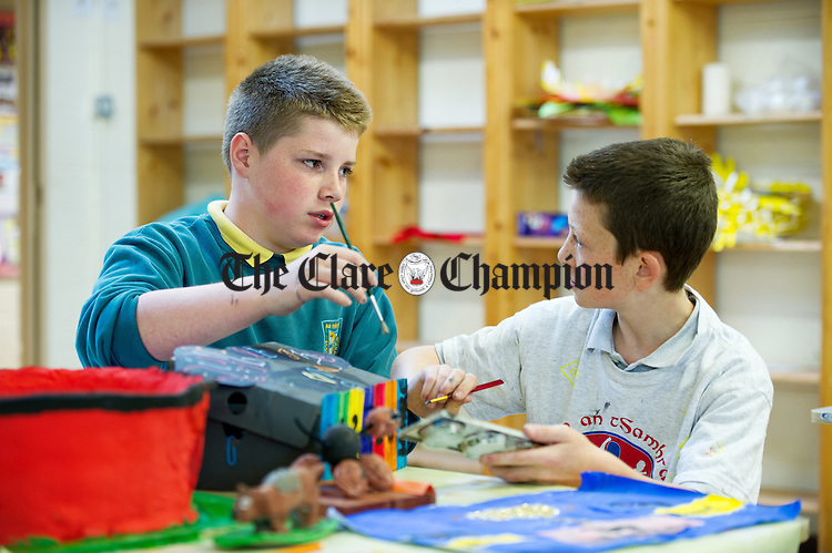 Evan and TJ working on their Night At The Dogs projects at St Flannan's  National School, Inagh. Photograph by John Kelly.