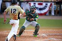 Siena Saints catcher Patrick Ortland (27) waits for a throw as Luke Hamblin (12) attempts to score a run during a game against the UCF Knights on February 21, 2016 at Jay Bergman Field in Orlando, Florida.  UCF defeated Siena 11-2.  (Mike Janes/Four Seam Images)