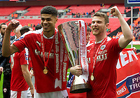 Ashley Fletcher of Barnsley (left) and Sam Winnall with the trophy after winning the Johnstone's Paint Trophy Final match between Oxford United and Barnsley at Wembley Stadium, London, England on 3 April 2016. Photo by Alan  Stanford / PRiME Media Images.