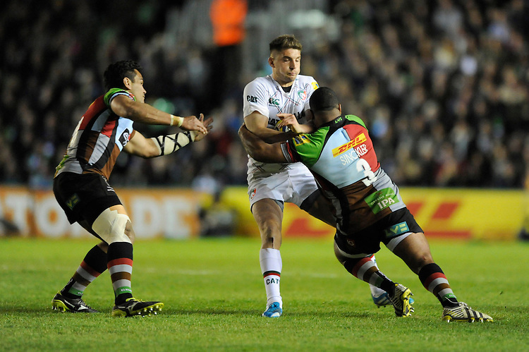 Owen Williams of Leicester Tigers is tackled by Kyle Sinckler of Harlequins as Maurie Fa'asavalu of Harlequins supports during the Aviva Premiership match between Harlequins and Leicester Tigers at the Twickenham Stoop on Friday 18th April 2014 (Photo by Rob Munro)