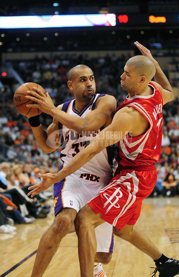 Mar. 22, 2008; Phoenix, AZ, USA; Houston Rockets forward (31) Shane Battier defends Phoenix Suns forward (33) Grant Hill at the US Airways Center. Mandatory Credit: Mark J. Rebilas