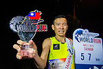 Male winner poses with the trophy at the Wings for Life World Run on May 2, 2015 in Yi-Lan, Taiwan. Photo by Victor Fraile / Power Sport Images