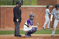 High Point Panthers catcher Brian Rall (20) looks to the dugout for the sign during the game against the Campbell Camels at Williard Stadium on March 16, 2019 in  Winston-Salem, North Carolina. The Camels defeated the Panthers 13-8. (Brian Westerholt/Four Seam Images)