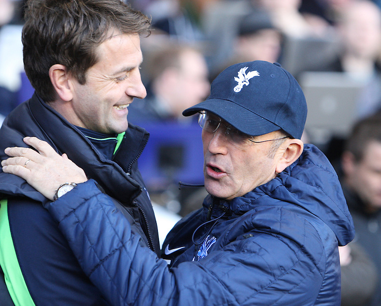 Tottenham Hotspur's Head Coach Tim Sherwood and Crystal Palace's Manager Tony Pulis <br /> <br /> Photo by Kieran Galvin/CameraSport<br /> <br /> Football - Barclays Premiership - Tottenham Hotspur v Crystal Palace - Saturday 11th January 2014 - White Hart Lane - London<br /> <br /> &copy; CameraSport - 43 Linden Ave. Countesthorpe. Leicester. England. LE8 5PG - Tel: +44 (0) 116 277 4147 - admin@camerasport.com - www.camerasport.com