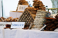 selling sausages of donkey, cow, wild boar and more at The market in Carpentras, Vaucluse, Rhone, Provence, France