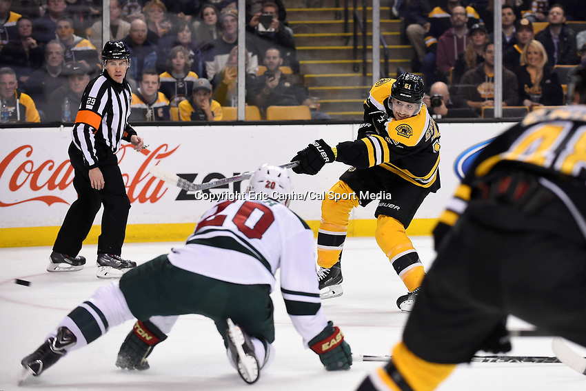 Thursday, November 19, 2015: Boston Bruins center Ryan Spooner (51) takes a shot at the net during the National Hockey League game between the Minnesota Wild and the Boston Bruins held at TD Garden, in Boston, Massachusetts. Eric Canha/CSM