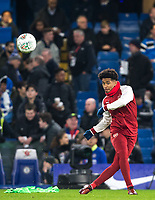Reiss Nelson of Arsenal warms up pre match during the Carabao Cup semi final 1st leg match between Chelsea and Arsenal at Stamford Bridge, London, England on 10 January 2018. Photo by Andy Rowland.