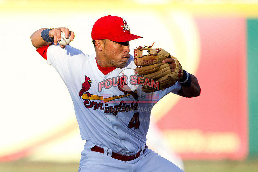 Kolten Wong (4) of the Springfield Cardinals turns a double play during a game against the Northwest Arkansas Naturals at Hammons Field on June 14, 2012 in Springfield, Missouri. (David Welker/Four Seam Images)