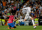 Almeria's goalkeeper Esteban Andres Suarez vies with Real Madrid's Welsh striker Gareth Bale during the Spanish league football match Real Madrid Madrid vs U.D Almeria at the Santiago Bernabeu stadium in Madrid on April 12, 2014  PHOTOCALL3000 / DP
