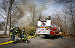 Manasquan Ladder 27-1-90 prepares to battle a structure fire on Pearce Avenue on Easter Sunday, April 1, 2018.