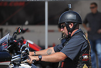 NWA Democrat-Gazette/ANDY SHUPE<br /> Visitors enjoy the sights Wednesday, Sept. 23, 2015, at the 16th annual Bikes, Blues &amp; BBQ motorcycle rally at the Baum Motorcycle Village at Baum Stadium in Fayetteville.