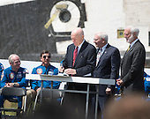 Former United States Senator John H. Glenn signs documents at the ceremony where the Space Shuttle Discovery is signed over to replace the Space Shuttle Enterprise at the Smithsonian Institution's Steven F. Udvar-Hazy Center in Chantilly, Virginia on Thursday, April 19, 2012.  .Credit: Ron Sachs / CNP..(RESTRICTION: NO New York or New Jersey Newspapers or newspapers within a 75 mile radius of New York City)