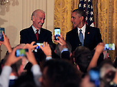 United States President Barack Obama tells a heckler to leave the East Room of the White House in Washington, DC as he hosts a reception to observe LGBT Pride Month on June 24, 2014. US Vice President Joe Biden looks on from left.<br /> Credit: Dennis Brack / Pool via CNP
