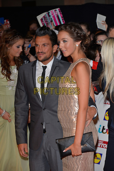 Peter Andre and Emily MacDonagh<br /> The Daily Mirror's Pride of Britain Awards arrivals at the Grosvenor House Hotel, London, England.<br /> 7th October 2013<br /> half length dress silver gold sleeveless grey gray suit pregnant couple black clutch bag profile <br /> CAP/PL<br /> &copy;Phil Loftus/Capital Pictures