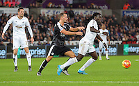 Bafetimbi Gomis of Swansea (R) against Danny Drinkwater of Leicester City during the Barclays Premier League match between Swansea City and Leicester City at the Liberty Stadium, Swansea on December 05 2015