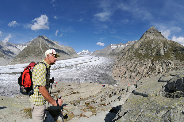 Switzerland, Valais, Western Europe, Jungfrau Region, Aletsch Glacier (UNESCO world heritage site). Senior hiker on the panorama trail between Bettmerhorn and Märjelensee. Note: No releases available.