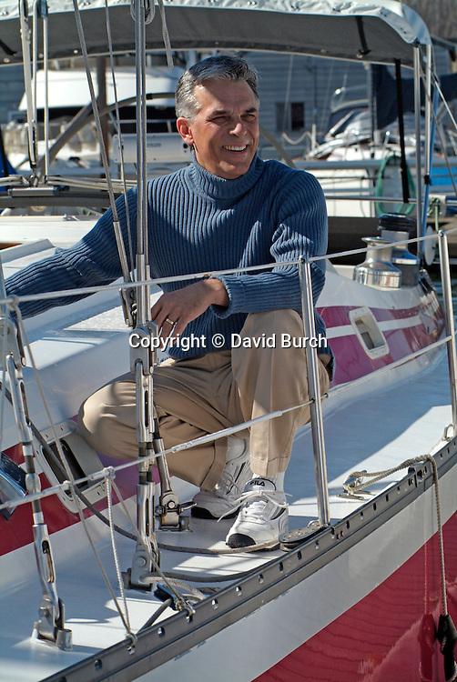 Man on sailboat in marina
