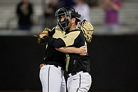 UCF Knights pitcher Jeffrey Hakanson (30) and catcher Josh Crouch (44) celebrate after closing out a game against the Siena Saints on February 14, 2020 at John Euliano Park in Orlando, Florida.  UCF defeated Siena 2-1.  (Mike Janes/Four Seam Images)