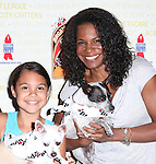 Audra McDonald & daughter Zoe Madeline .backstage at Broadway Barks 14 at the Booth Theatre on July 14, 2012 in New York City. Marking its 14th anniversary, Broadway Barks!, founded by Bernadette Peters and Mary Tyler Moore helps many of New York City's shelter animals find permanent homes and also inform New Yorkers about the plight of the thousands of homeless dogs and cats in the metropolitan area.