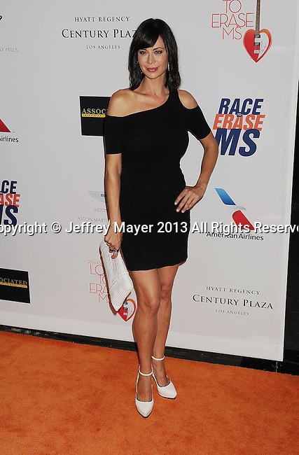 CENTURY CITY, CA- MAY 03: Actress Catherine Bell arrives at the 20th Annual Race To Erase MS Gala 'Love To Erase MS' at the Hyatt Regency Century Plaza on May 3, 2013 in Century City, California.