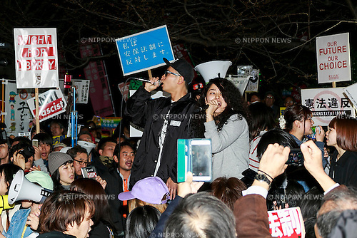 Members of SEALDs chant in front of the Japanese Diet building during a protest against new security legislation which comes into effect form today March 29, 2016, in Tokyo, Japan. Last Tuesday, Prime Minister Shinzo Abe's Cabinet decided to give the green light to a change in the interpretation of the country's post war constitution that will allow Japan's Self-Defence Forces to fight alongside the US and other allies in overseas conflicts. The new legislation could also see Japanese Self-Defence Forces dispatched to United Nations peacekeeping operations. Many Japanese oppose the new legislation and fear that it could see their country being dragged into overseas conflicts. The Abe government in turn sees the change as a chance to become more actively involved in the international community. (Photo by Rodrigo Reyes Marin/AFLO)