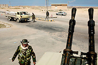 FIghters check a vehicle at a rebel checkpoint on the edge of Tobruk that guards the desert road from Agdabia. On 17 February 2011 Libya saw the beginnings of a revolution against the 41 year regime of Col Muammar Gaddafi. .