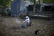 Liz Lindsey keeps six bee hives in the backyard of her home in Chapel Hill, N.C., Sat., September 25, 2010. One of the larger hives contains nearly 200,000 bees, which generates a lot of honey. .