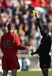 16 December 2007: Referee Misail Tsapos (r) shows the yellow card to Ohio State's Doug Verhoff (15). The Wake Forest University Demon Deacons defeated the Ohio State Buckeyes 2-1 at SAS Stadium in Cary, North Carolina in the NCAA Division I Mens College Cup championship game.