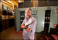 BNPS.co.uk (01202 558833)<br /> Pic: PhilYeomans/BNPS<br /> <br /> Owner Trevor Lethbridge in the vast transformer room.<br /> <br /> Fed up with your neighbours...This Cold War bunker boasting 56 rooms, metre thick walls and no windows could be the perfect country retreat.<br /> <br /> The former top secret nuclear bunker on a remote Devon clifftop was built to shelter local officials in the chilling event of a Soviet strike on nearby Plymouth.<br /> <br /> The 30,000 sq ft shelter, built at the height of the Cold War in 1952, boasts heavy steel blast doors and its 375 kva generator can provide enough heat and light to keep up to 150 people safe for several months.<br /> <br /> It's 56 rooms were kitted out as bedrooms, living spaces, and mess rooms so that the administration could continue running the county even after a nuclear strike.<br /> <br /> Codenamed Hope Cove R6, it was finally decommissioned in 1999 and bought by local farmers Trevor Lethbridge and his friend Derek Brooking, who have used it as an archive storage system and a venue for charity and art events.<br /> <br /> The pair are now selling it through Clive Emson Auctioneers in Maidstone, Kent.
