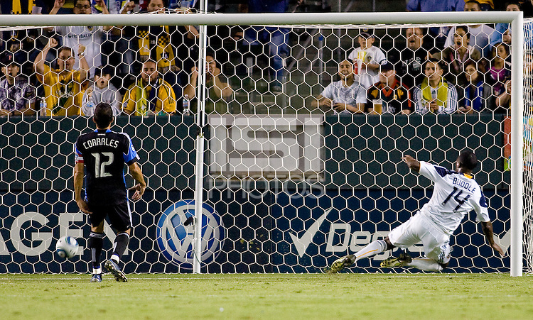 LA Galaxy forward Edson Buddle (14) scores a goal off San Jose Earthquakes defender Ramiro Corrales (12). The LA Galaxy and the San Jose Earthquakes played to a 2-2 draw at Home Depot Center stadium in Carson, California on Thursday July 22, 2010.