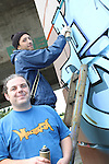 Darren Finnegan with artist Tea at the 2010 Graffiti Jam under the Bridge of Peace in Drogheda. ..Picture Jenny Matthews/Newsfile.ie