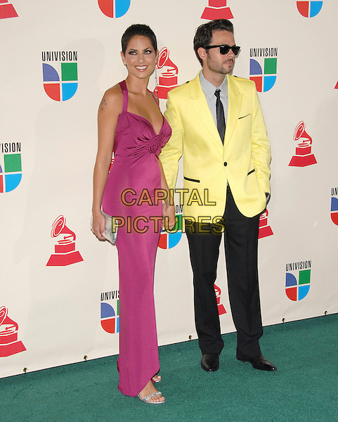 BARBARA MORI & GUEST.The 8th Annual Latin Grammys held at The Mandalay Bay Hotel & Casino in Las Vegas, California, USA..November 8th, 2007.full length pink dress yellow suit jacket sunglasses shades black trousers.CAP/DVS.©Debbie VanStory/Capital Pictures