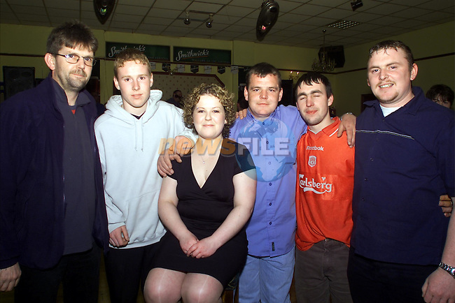 Mirmiam Moore, centre, who organised the charity night in O'Neills pictured with l to r Johnny, Colin Wood, Martin Healy, Patrick Andrews and Wesley Coleman who were all getting their heads shaved for the cancer charity night..Picture: Arthur Carron/Newsfile
