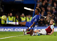 11th January 2020; Stamford Bridge, London, England; English Premier League Football, Chelsea versus Burnley; Tammy Abraham of Chelsea stretches to take a shot on goal - Strictly Editorial Use Only. No use with unauthorized audio, video, data, fixture lists, club/league logos or 'live' services. Online in-match use limited to 120 images, no video emulation. No use in betting, games or single club/league/player publications