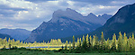 Banff National Park, Alberta, Canada    <br /> Mount Rundle reflecting on Vermillion Lake with sun breaks lighting the distant wetland trees